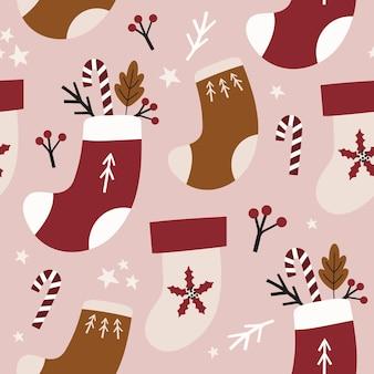 Nahtloses weihnachtsmuster mit strümpfen