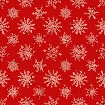 Nahtloses weihnachtsrotes muster mit gezogenen schneeflocken