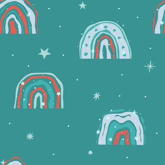 Nahtloses wintermuster. regenbogen und schneeflocken auf grünem hintergrund. vektor-illustration.