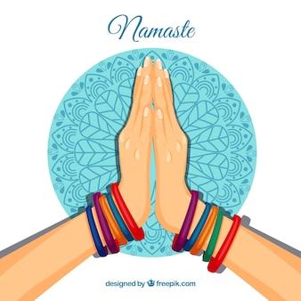 Namaste geste mit bunten bacelets