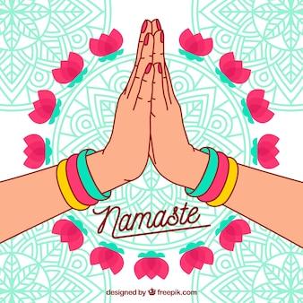 Namaste hintergrund mit mandalas und hand gezeichneten händen