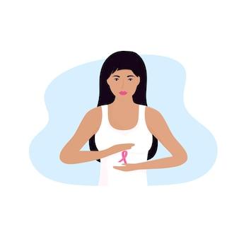 Nationaler monat zur aufklärung über brustkrebs. junge frau, die rosa satinband in ihren händen hält.