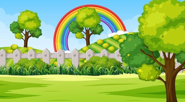 Naturparkszenenhintergrund mit regenbogen im himmel