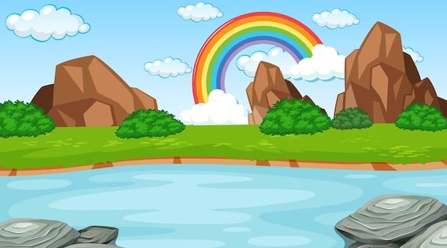 Naturszenenhintergrund mit regenbogen im himmel