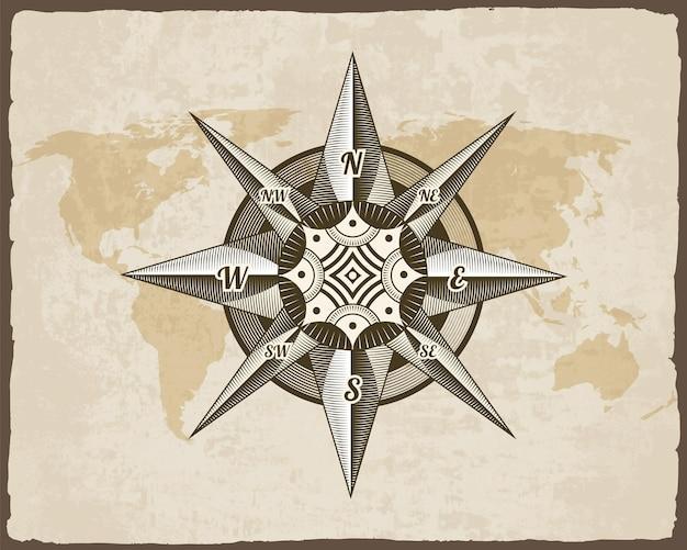 Nautisches antikes kompasszeichen auf alter papierbeschaffenheitsweltkarte mit zerrissenem randrahmen. element für meeresthema und heraldik. vintage wind rose label emblem.