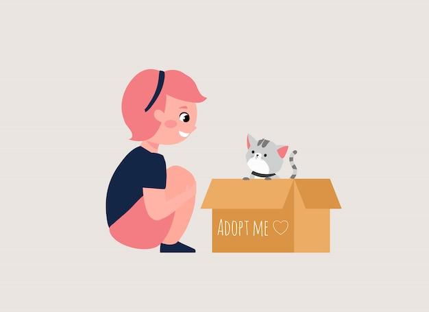 Nehmen sie ein haustierkonzept mit mädchen- und katzenkarikaturillustration an. niedliche kleine kate in pappkarton mit adoptieren mich text