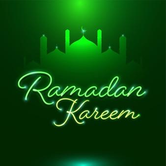 Neon-effekt ramadan kareem schriftart mit silhouette moschee