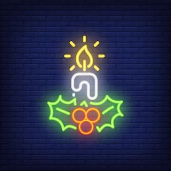 Neonkerze und mistelzweige. festliches element. weihnachts-konzept