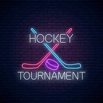 Neonschild des hockeyturniers mit hockeyschlägern und puck.