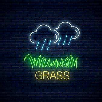 Neonzeichen der regnerischen wolken und des grundstücks des grases auf dunkler backsteinmauer
