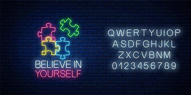 Neonzeichen des glaubens an sich selbst inschrift mit puzzleteilen und alphabet. löse das puzzlespiel.