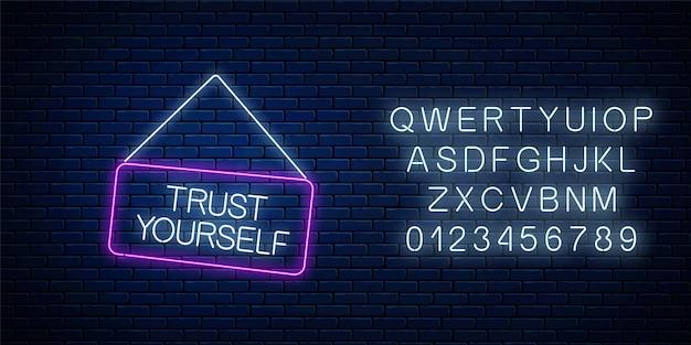 Neonzeichen des vertrauens selbst inschrift auf hängendem brett mit alphabet. m.