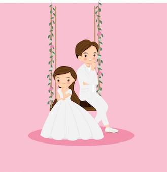 Nette braut und bräutigam im weißen kleid sitzen zusammen