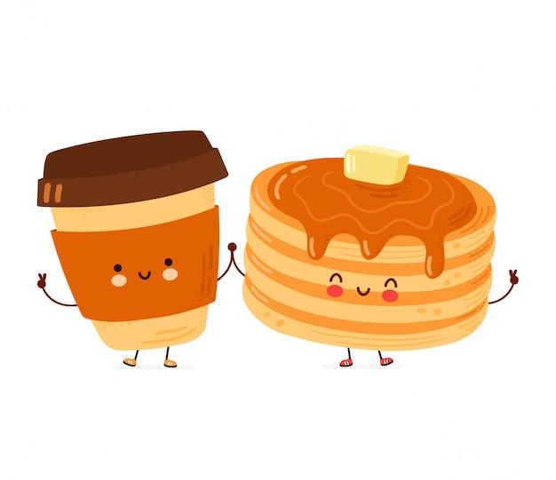 Nette glückliche lustige pfannkuchen und kaffeetasse. isoliert
