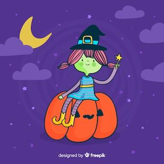 Nette halloween-hexe auf einem kürbis