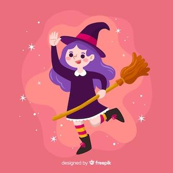 Nette halloween-hexe auf rosa hintergrund