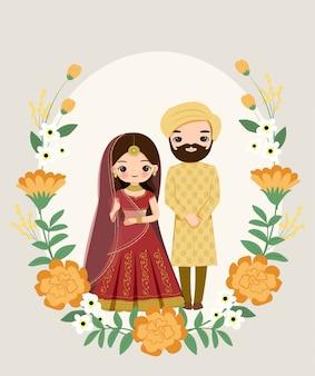 Nette indische paare im trachtenkleid auf blumenhochzeits-einladungskarte