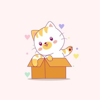 Nette katze, die mit kastenkarikatur spielt