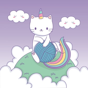 Nette katze mit regenbogenendstück und wollball kawaii charakter