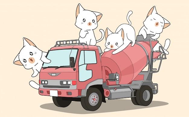 Nette katzen auf betonmischer-lkw