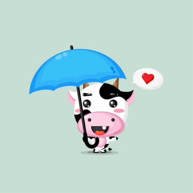 Nette kuh, die einen regenschirm trägt