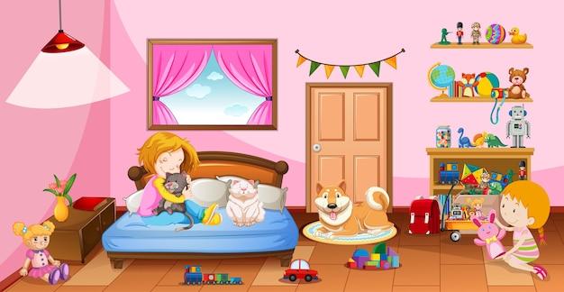 Nette mädchen, die mit ihren spielzeugen in der rosa schlafzimmerszene spielen