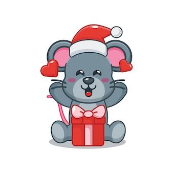 Nette maus mit weihnachtsmütze mit geschenkbox am weihnachtstag nette weihnachtskarikaturillustration