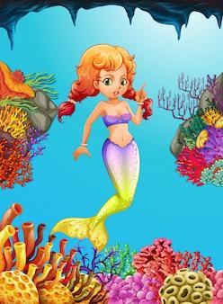 Nette meerjungfrau, die unter dem ozean schwimmt