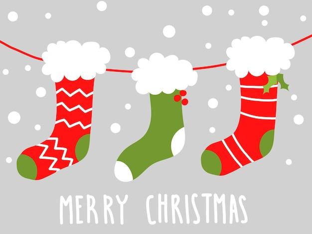 Nette postkarte des weihnachtsvektors mit strümpfen
