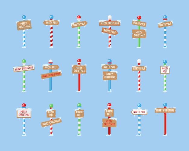 Nette sammlung von nordpolzeichen oder weihnachten. satz hölzerne straßenschilder im schnee, winterzeiger im flachen stil. winterferienweihnachtssymbol, karikaturbanner.
