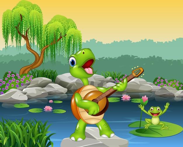 Nette schildkröte, die gitarre auf felsen spielt