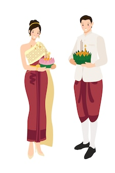 Nette thailändische paare im traditionellen roten kleid auf sich hin- und herbewegendem blumen loy krathong-festival