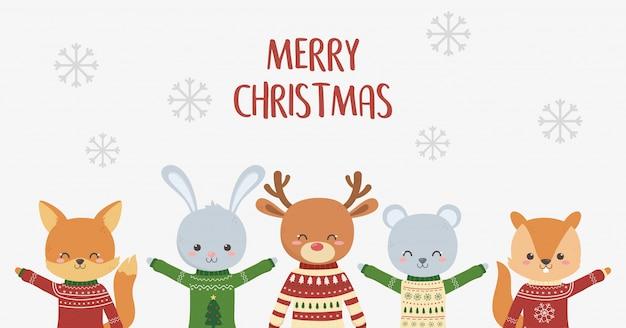 Nette tiere der feier der frohen weihnachten mit hässlichen strickjackeschneeflocken