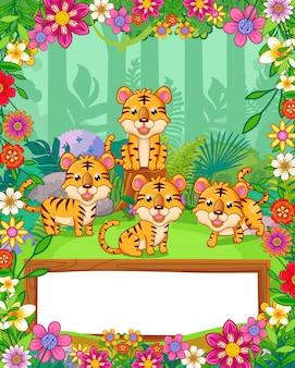 Nette tiger mit blumen und hölzernem freiem raum unterzeichnen herein den wald. vektor