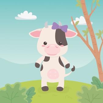Nette und kleine kuh auf dem gebiet
