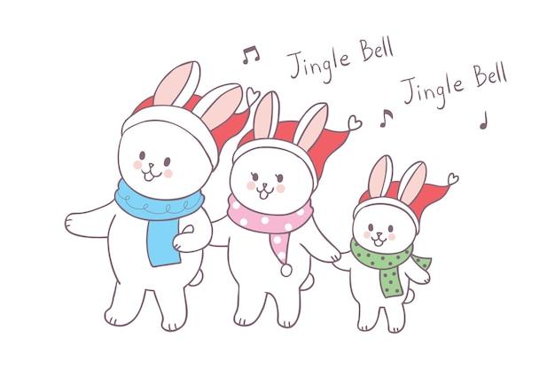 Nette weihnachtsfamilienkaninchen der karikatur singen einen liedvektor.