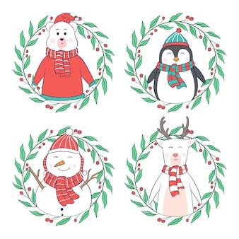 Nette weihnachtsfiguren mit blumen- oder kranzrahmen