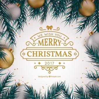 Nette weihnachtsgruß mit dekorativen kugeln und goldenen details