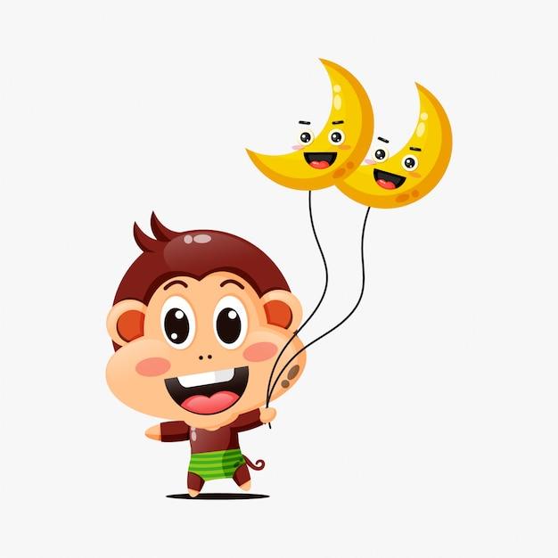 Netter affe, der einen mondballon hält