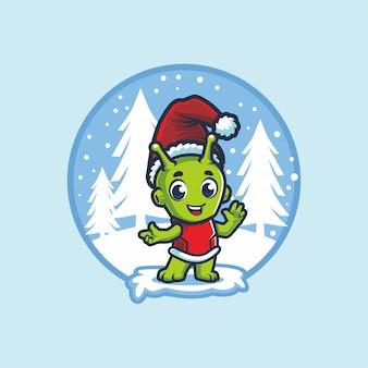 Netter alien mit santa hat im winter cartoon maskottchen design
