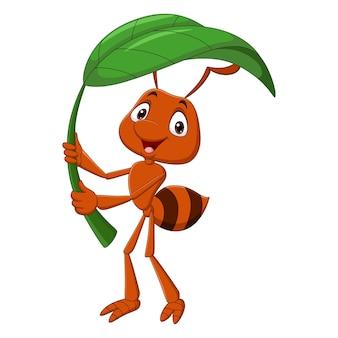 Netter ameisenkarikatur, der grünes blatt hält