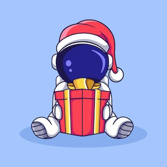 Netter astronautencharakter, der mit weihnachtsgeschenkbox sitzt. flache karikaturartillustration.