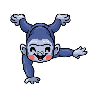 Netter baby-gorilla-cartoon auf den kopf gestellt