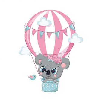 Netter baby-koalabär auf einem heißluftballon. illustration