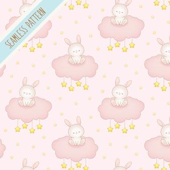 Netter babyhase auf einem nahtlosen muster der rosa wolke