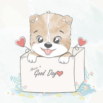 Netter babyhund in einer box-aquarellkarikaturhand gezeichnete illustration