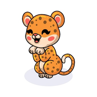 Netter babyleopard-cartoon posiert