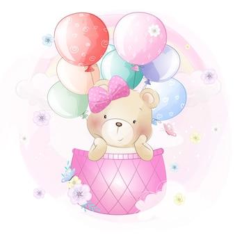 Netter bär, der mit luftballon fliegt