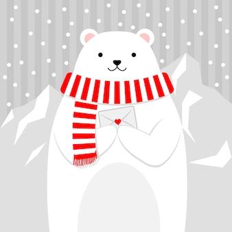 Netter bär im schnee, der einen buchstaben hält