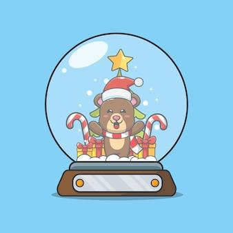Netter bär in der schneekugel nette weihnachtskarikaturillustration